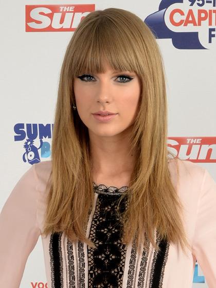 Taylor Swift com cabelos longos
