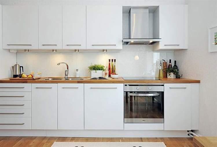 cozinha planejada pequena compactada em uma parede