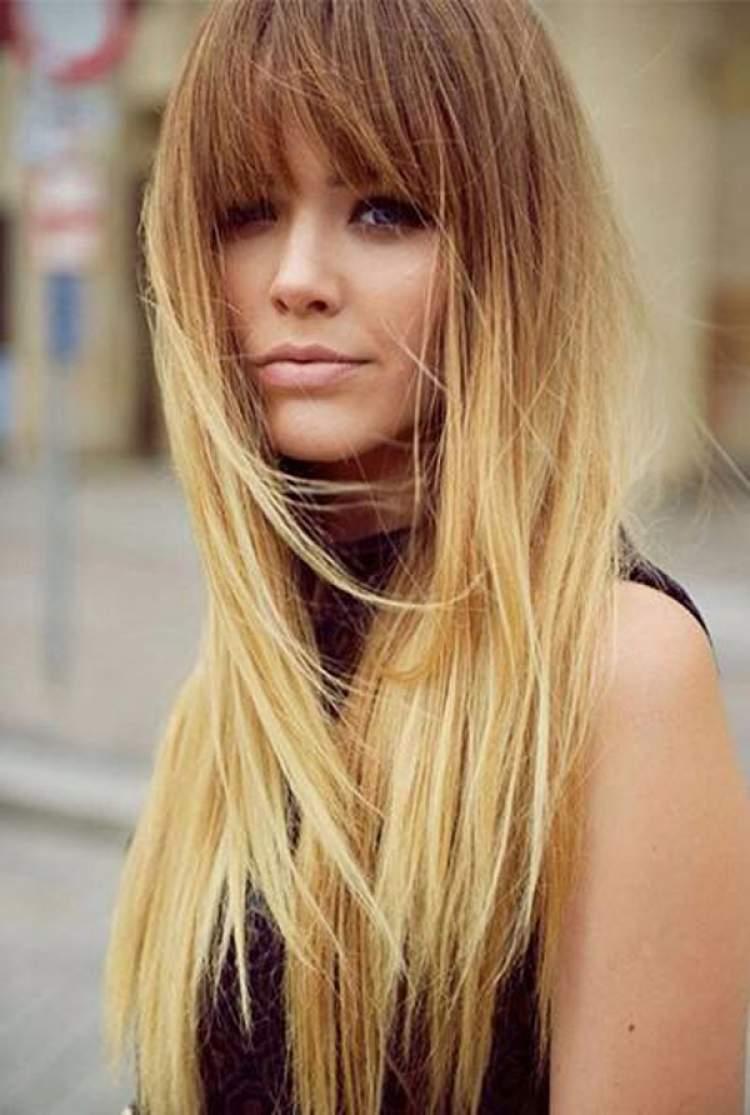 Corte de cabelo longo com franja grande
