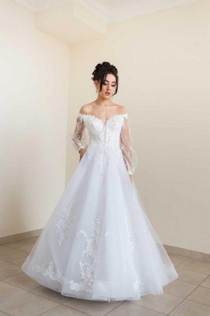 vestido de noiva de organza e manga longa transparente