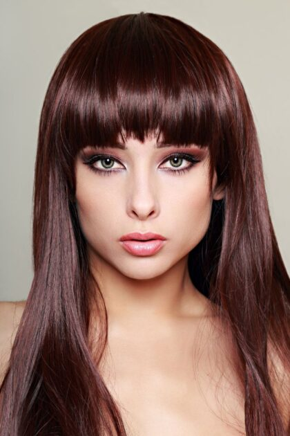 Corte de cabelo longo com franja